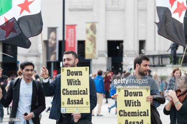 A group of protesters stage a demonstration in Trafalgar Square in London on the 4th anniversary of the Ghouta chemical attacks which occured on 21...