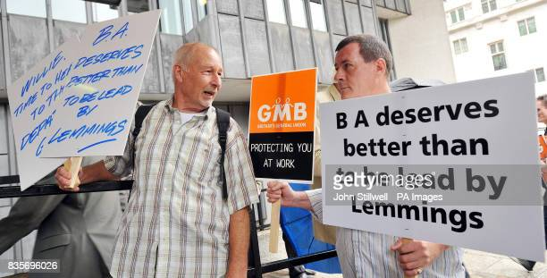 A group of protesters stand outside the BA Annual General Meeting at the Queen Elizabeth centre London