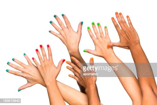 Group of raised multiethnics female hands with colored manicure