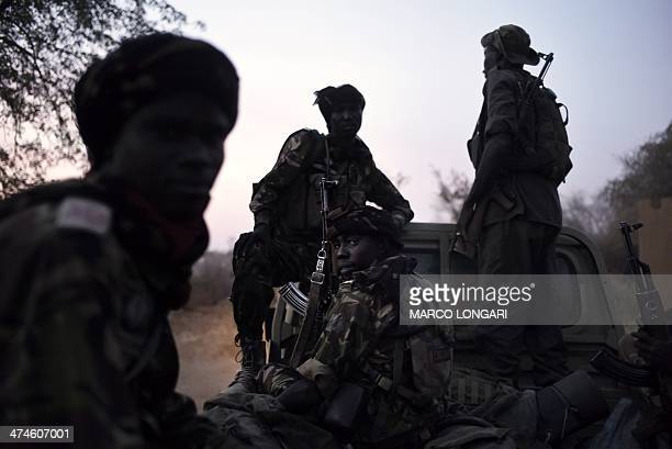 A group of rangers gather at the Zakouma National Park in Chad before a patrol on February 24 2014 Rangers are of vital importance in the park which...