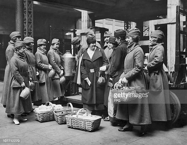 A group of Red Cross workers who have taken over the distribution of coffee and cigarettes to soldiers on the way to France circa 1918