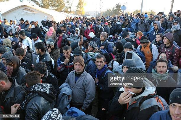 A group of refugees stranded on the border between Greece and Macedonia near the southern Macedonian town of Gevgelija wait to cross border on...