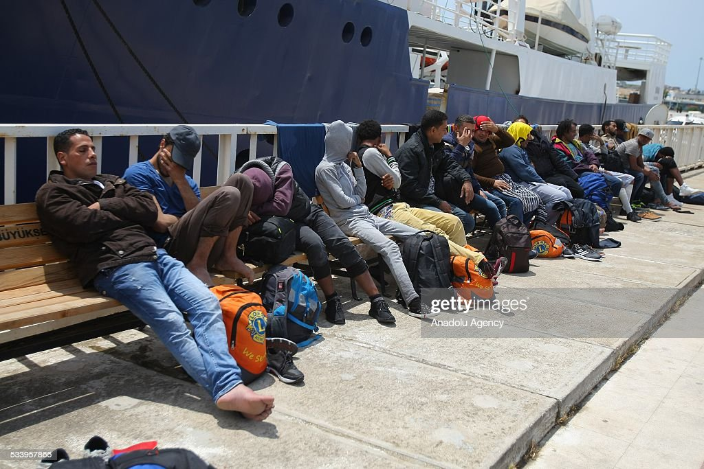A group of refugees wait after they were captured by coast guard while trying to pass illegally to Chios of Greek from Cesme in Izmir, Turkey on May 24, 2016. Turkish coast guard captured approximately 42 refugees after the operation.