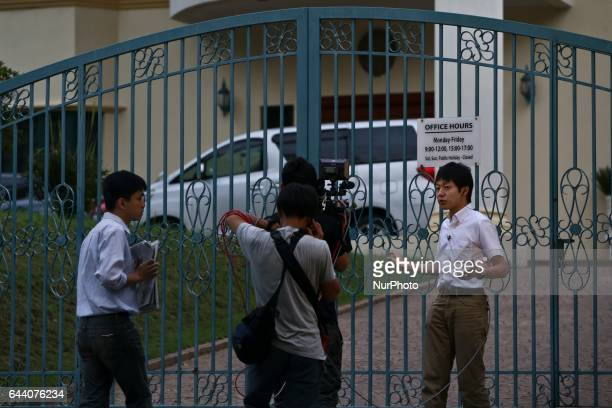 A group of reporter doing a live record holds up a local newspaper in front of the North Korea Embassy at Kuala Lumpur on February 23 2017...
