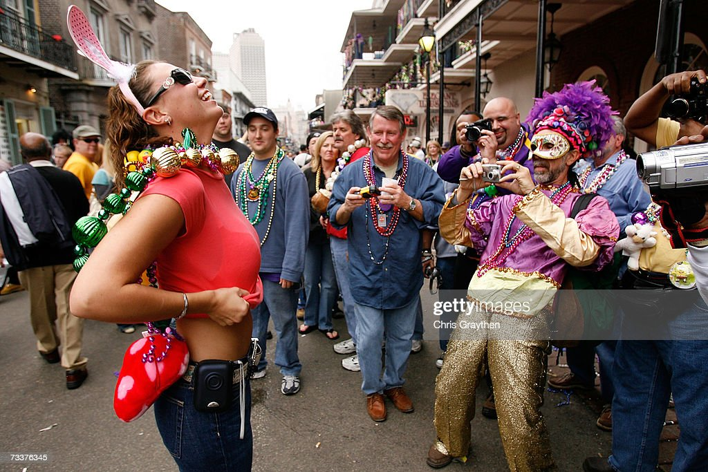A group of revelers with cameras wait to capture a moment on Bourbon Street on Mardi Gras Day February 20 2007 in New Orleans Louisiana This is the...