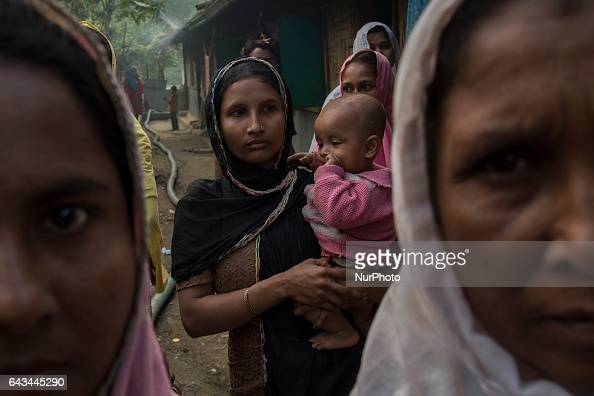 A group of Rohingya women walking towards an uncertain future Kutupalong Bangladesh 210217 The Rohingya Muslim refugees of Bangladesh are originally...