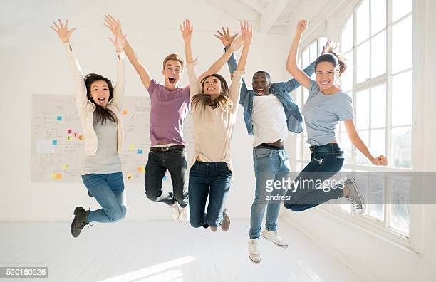 Group of roommates jumping of excitement