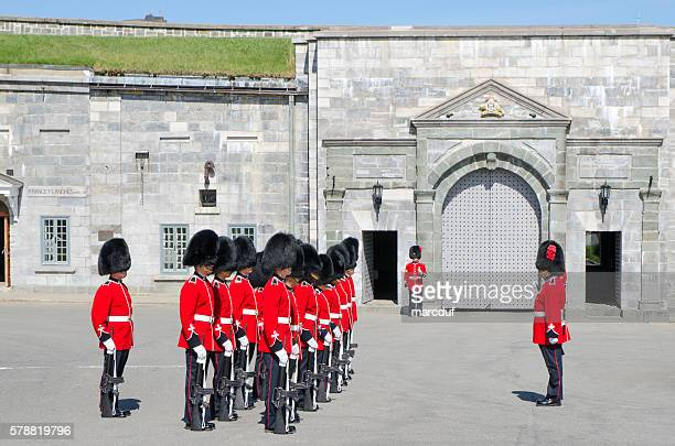 Group of Royal Guards inspected by officer