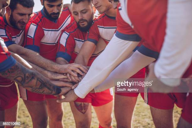 Group of rugby players huddling during time out
