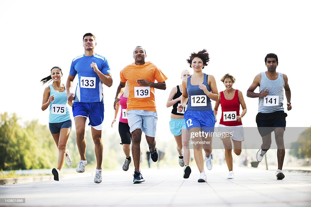 Group of runners in a cross country race. : Stock Photo