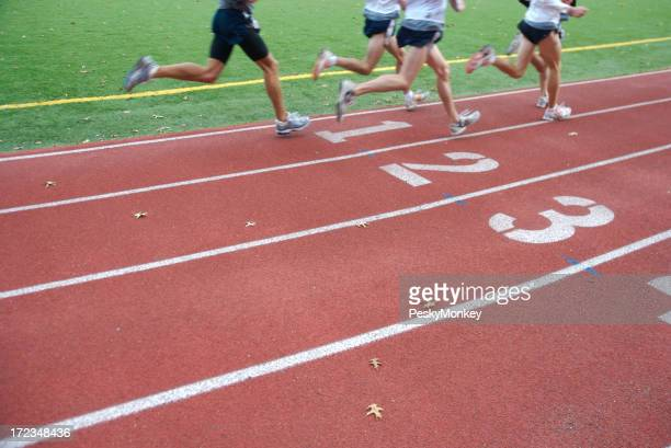 Group of Runners Near the Finish Line on Running Track