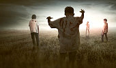 Group of scary asian zombies walking around against dramatic sky background