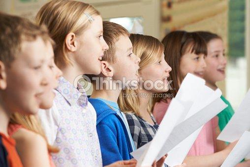 Group Of School Children Singing In School Choir