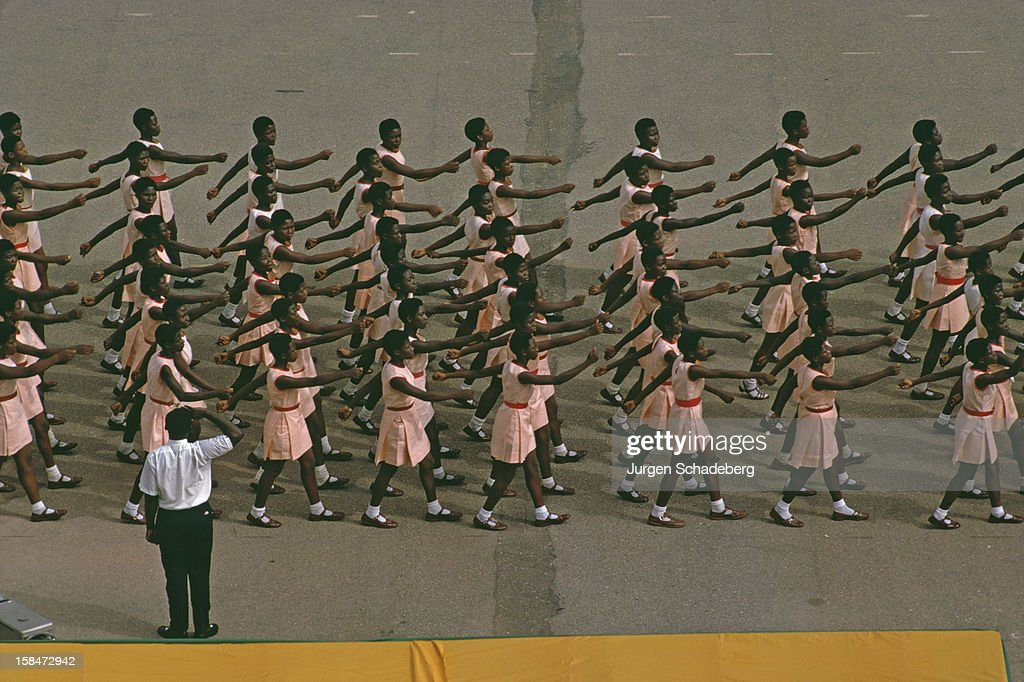 A group of schoolgirls march past during an Independence Day Parade in Accra, Ghana, West Africa, 6th March 1973.