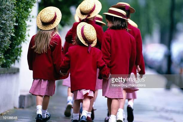 A group of schoolgirls, walking