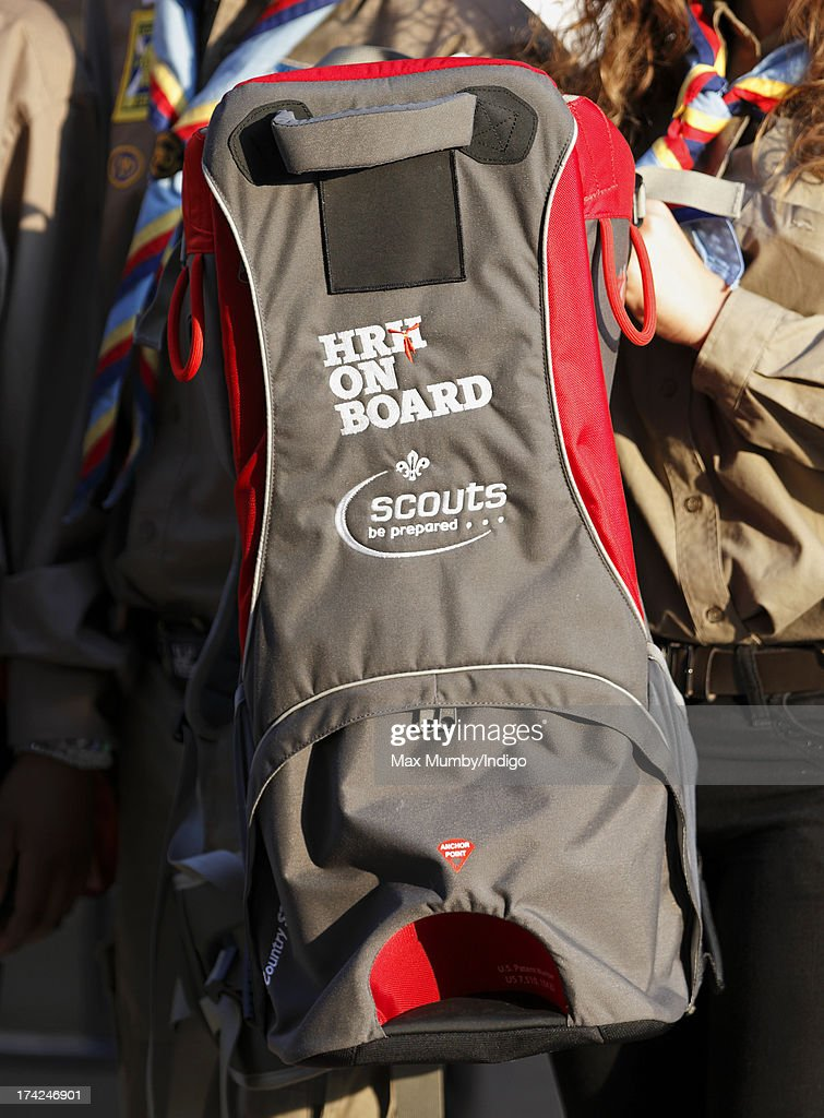 A group of Scouts pose with a baby carrier with 'HRH On Board' written on it whilst they wait for news of the birth of the first child of The Duke and Duchess of Cambridge outside The Lindo Wing at St Mary's Hospital on July 22, 2013 in London, England.