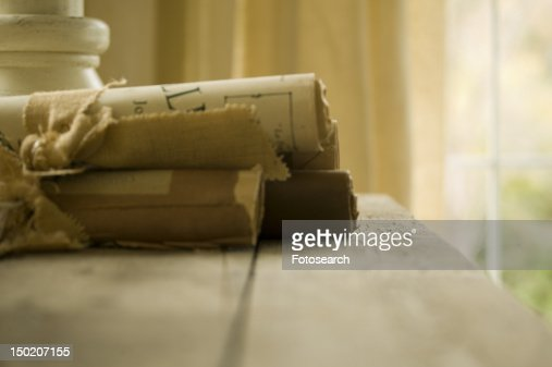 Group of scrolls on wooden table