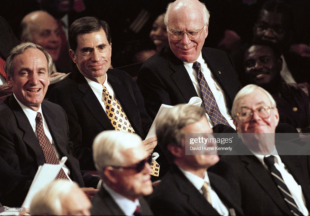 A group of senators, including Pat Leahy (D-CT) and Pat Moynihan (D-NY) listen to President Bill Clinton's State of the Union speech before a joint session of Congress on January 20, 1999.
