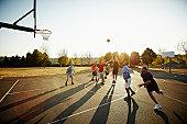 Group of senior and mature men playing basketball