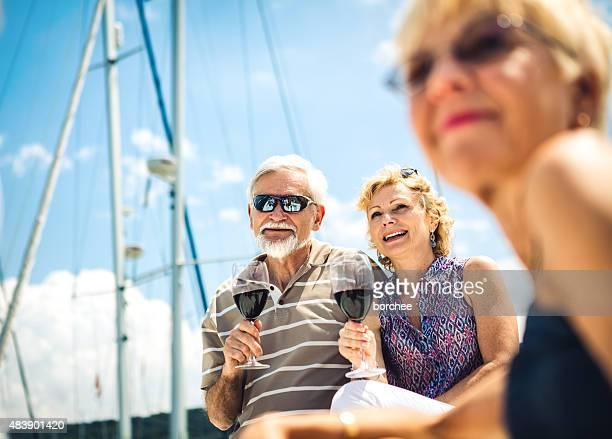 Group Of Senior Friends Enjoying On The Yacht