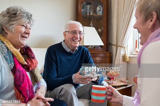 Group Of Senior Friends Meeting At Home For Coffee : Stock Photo