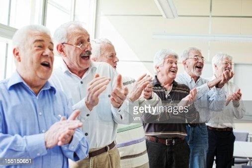 Group of senior men applauding