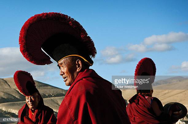 A group of senior monks gather for a ceremony on a field outside of Lo Manthang Hidden in the rain shadow of the Himalaya in one of the most remote...