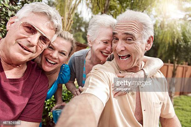 Group of senior people taking selfie