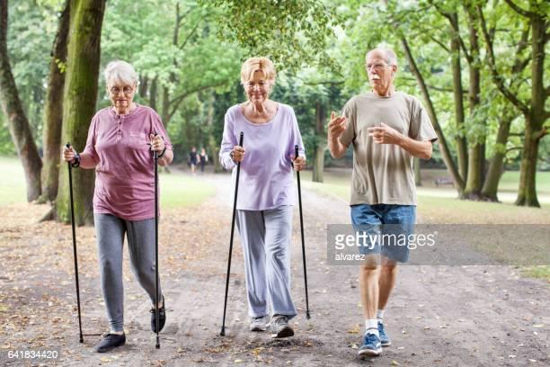 Group of senior walking through park