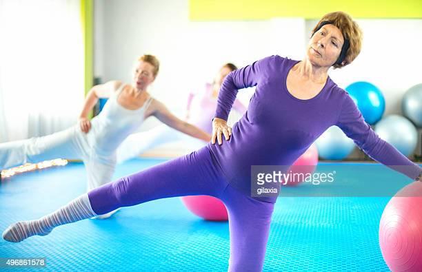 Group of senior women doing Pilates.
