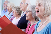 Group Of Seniors Singing In Choir Together