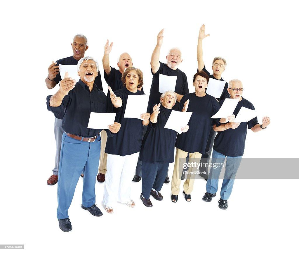 Group of seniors singing on white