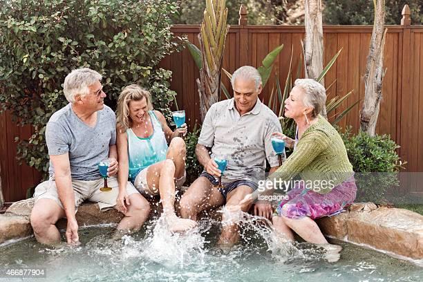 Group of seniors splashing in the jacuzzi