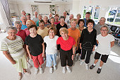 Group of seniors standing together after exercise class
