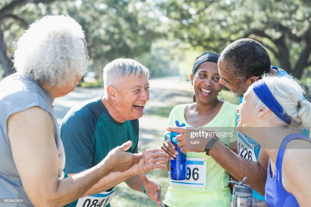 Group of seniors talking at end of race : Stock Photo