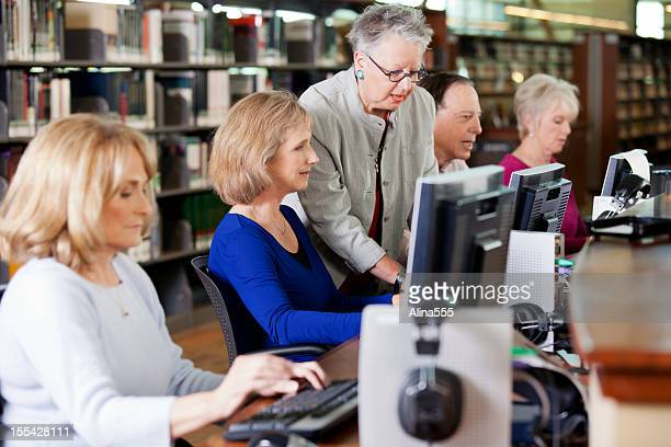 Group of seniors working in a computer lab