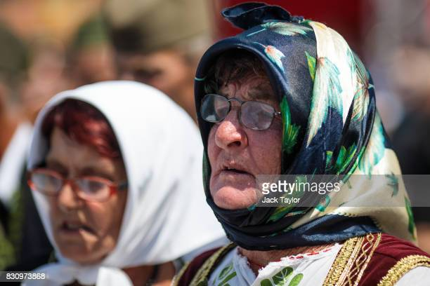 A group of Serbians in traditional dress parade through the town during the Guca Trumpet Festival on August 12 2017 in Guca Serbia Thousands of...