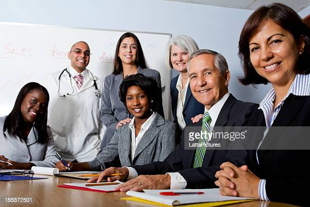 Group of seven multi-ethnic and mixed aged professionals