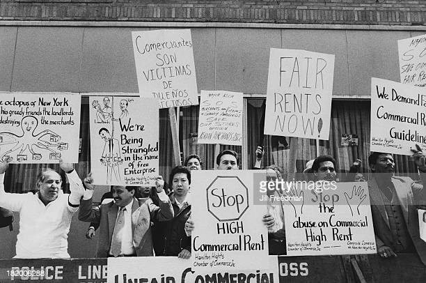 A group of shop owners hold signs at a protest against raised commercial rents in New York City 1986