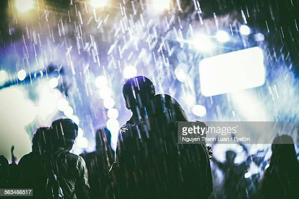 Group Of Silhouette People In The Rain