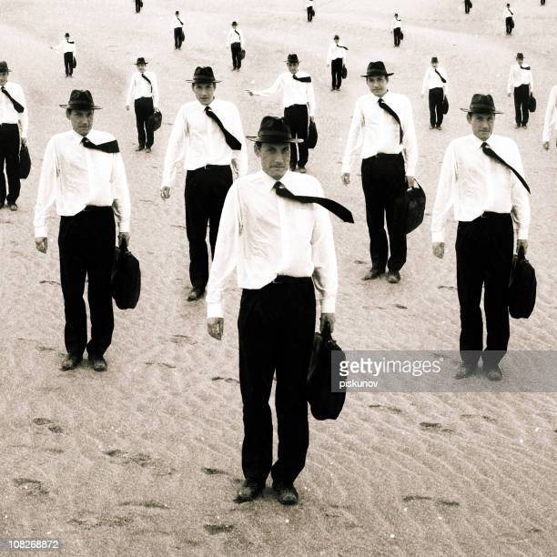 Group of Similiar Men Standing on Sand