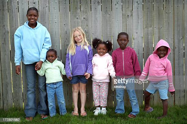 Group of Six Children Holding Hands