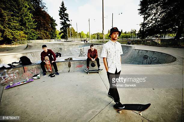 Group of skaters relaxing in skate park