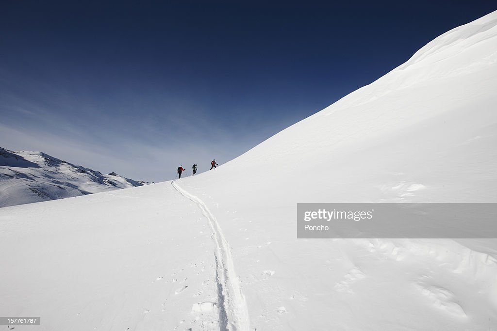Group of Skier walking up a mountain : Stock Photo