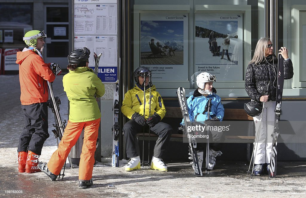 A group of skiers are seen waiting at a bus stop in the town of Davos, Switzerland, on Saturday, Jan. 19, 2013. Next week the business elite gather in the Swiss Alps for the 43rd annual meeting of the World Economic Forum in Davos, the five day event runs from Jan. 23-27. Photographer: Chris Ratcliffe/Bloomberg via Getty Images