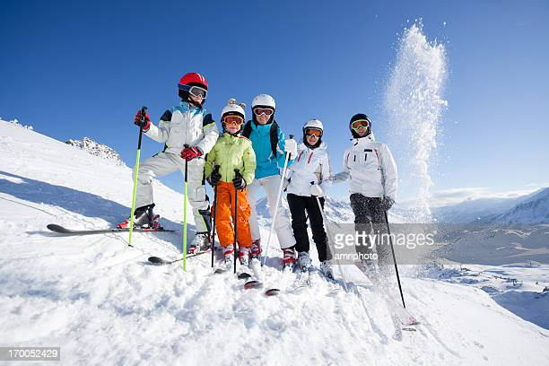 group of skiers with blue sky