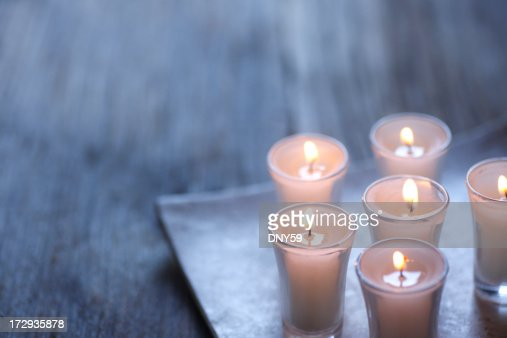 Group of small lit votive candles
