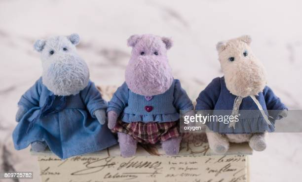 Group of Small Toys Hippo is sitting on a vintage box