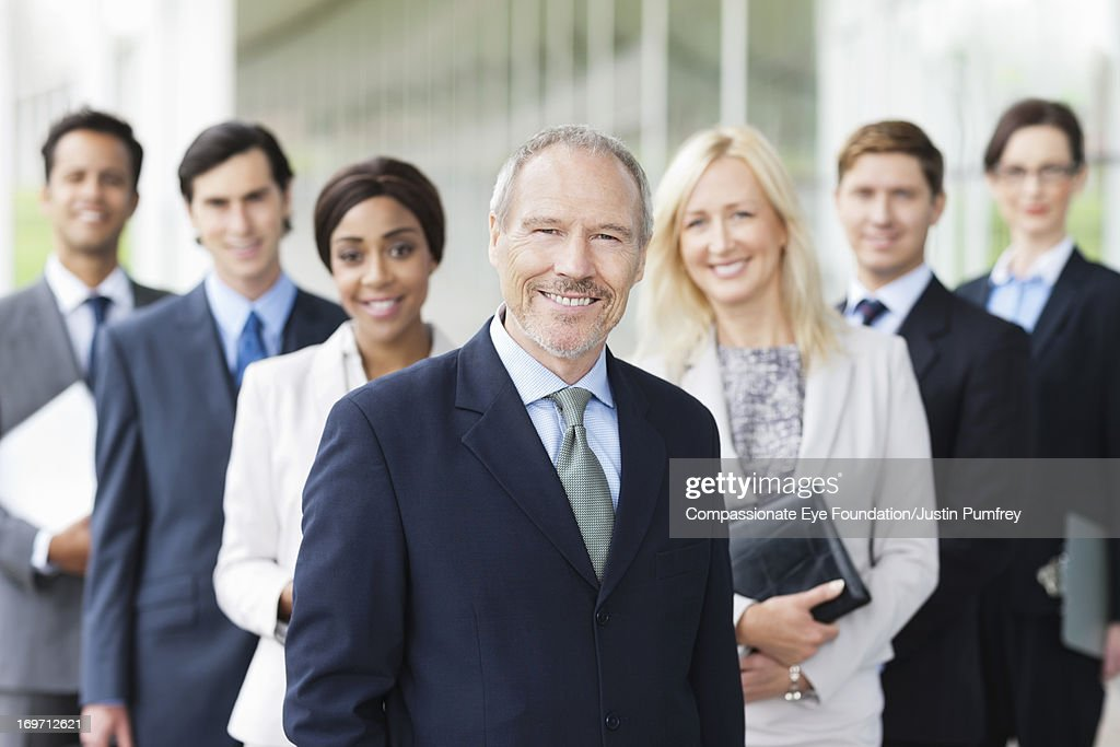 Group of smiling business people outdoors : Photo
