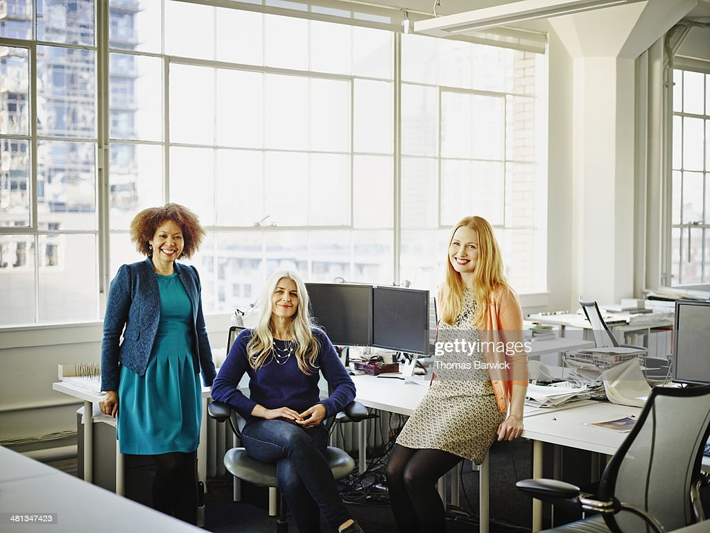 Group of smiling businesswomen in office : Stock Photo